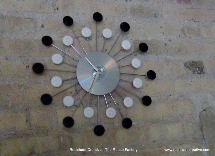 Wall Clock with recycled filters and capsules – Reloj de pared con filtros y…