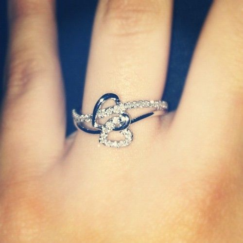 Such a pretty and delicate engagement / promise ring!