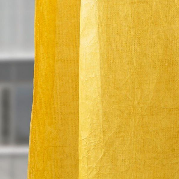 Eye-catching yellow. The entire surface of the SKATER curtain is coated in slightly transparent colour pigments. This allows the vivid structure of the textile to shine through.  #kinnasand #curtains #interior #design #isaglink #texture #light #window #interior #lovecolour