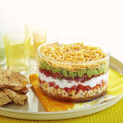 With homemade refried beans and garden-fresh salsa and guacamole, our hearty seven-layer dip delivers less sodium and more flavor, with only one-sixth the saturated fat and one-third fewer calories.