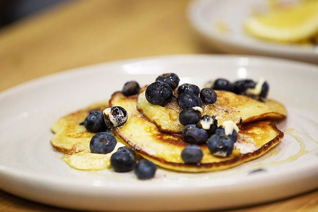 Ricotta hotcakes with blueberries, cinnamon & whipped cream. Photo: supplied .