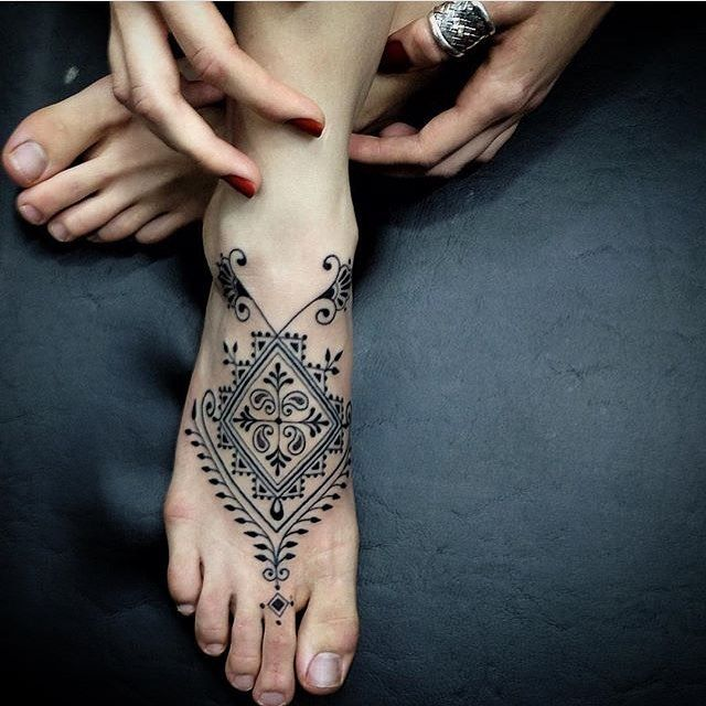 I usually don't like foot tattoos but this is stunning!                                                                                                                                                                                 More