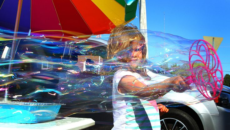 Olivia Kazolias, 6, of Pembroke enjoys making bubbles at the Scituate Farmers Market, Wednesday, July 27, 2016. Gary Higgins/The Patriot Ledger