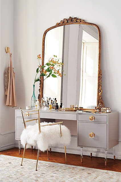Lacquered Regency Desk - anthropologie.com  Thinking about a vanity piece for the wall opposite our bed. There's no natural light in the closet or bathroom, so it would be nice to have a mirror in natural light. Ideally a vanity that maybe had a bench option for putting on shoes - or drying hair. (don't like this mirror)