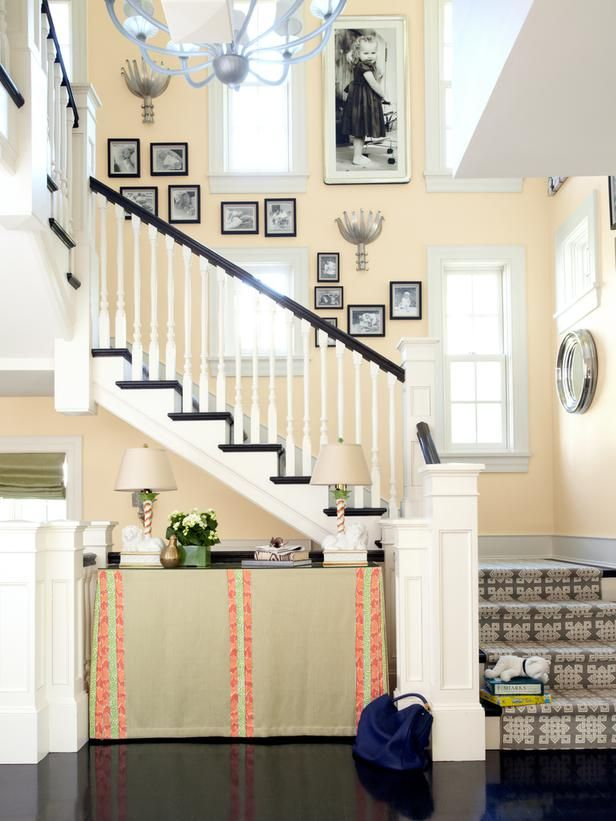 Pictures line the stairs to create a gallery wall in the home of designer Ramey Caulkins. I am in love with that stair runner!Wall Colors, Wall Decor, Mixed Painting Colors, Decor Ideas, Living Room, Gallery Walls, Paint Colors, Families Photos, Hgtv Magazine