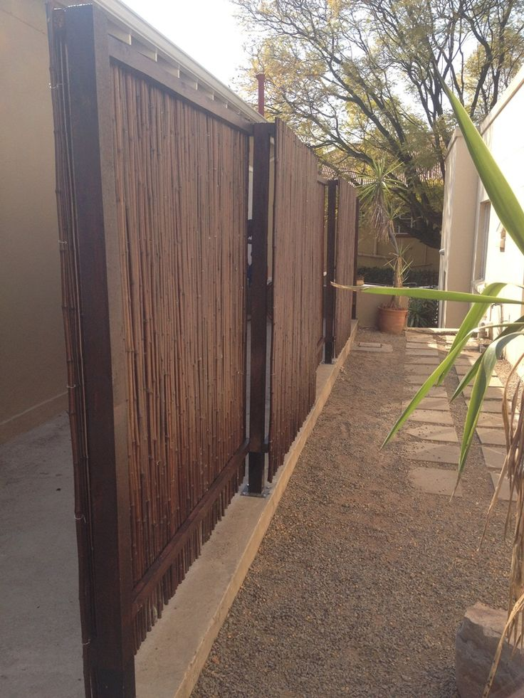 Mahogany bamboo fencing used to create a screen division between 2 tenants on the same property.