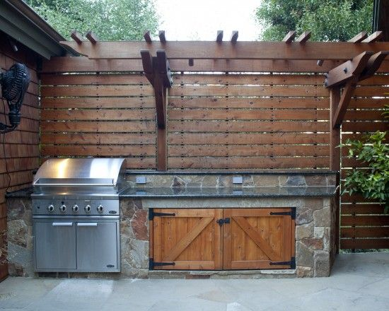 Outdoor bbq with wood trellis above kind of like this for Rustic outdoor privacy screens