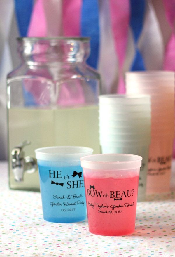 Add mystery to your gender reveal baby shower with these fun color changing cups. Once these cups get cold they show off their true colors changing to either blue or pink. All you need is a cold beverage. Great for setting next to the punch bowl for an alternating blue and pink color scheme to accent a gender reveal baby shower party. Afterwards, your guests can take them home as souvenirs. The cups can be ordered at http://www.tippytoad.com/16-oz-personalized-color-changing-stadium-cups.asp