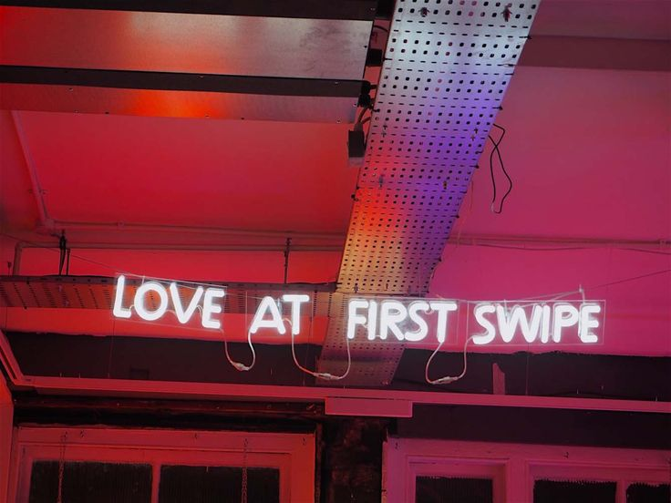 'Live at first swipe' Neon, 2015 by artist Mark Goede