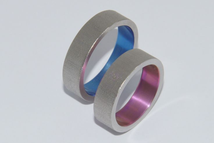 Titanium wedding rings, colored in pink and blue