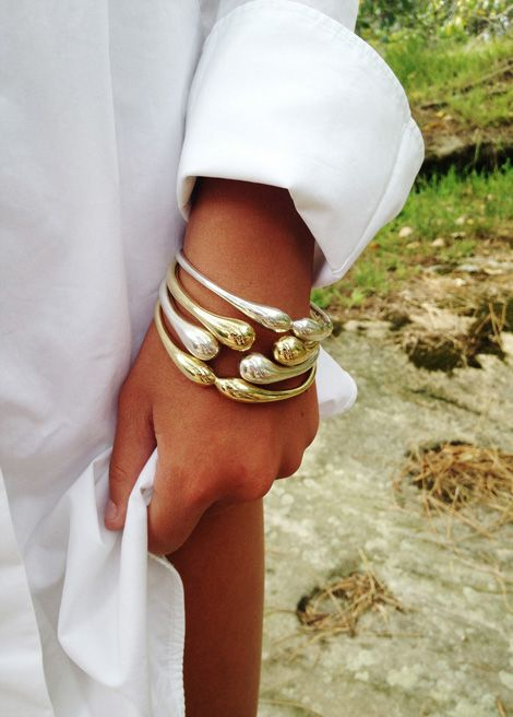 Dinosaur Designs Seed Pod 2014 - Brass  Silver Sprout bangles. Designed by Louise Olsen. Photographed by Tim Georgeson.