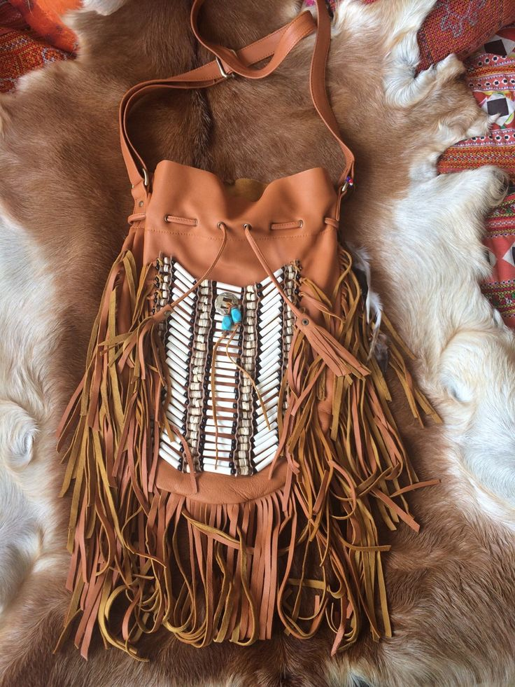 A personal favourite from my Etsy shop https://www.etsy.com/au/listing/210776459/large-leather-fringe-bag