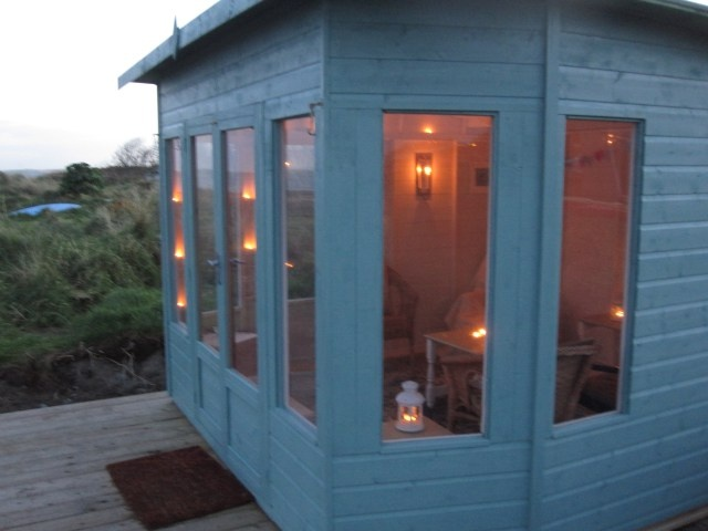 a waltons helios summerhouse at the beach candles provide the perfect light