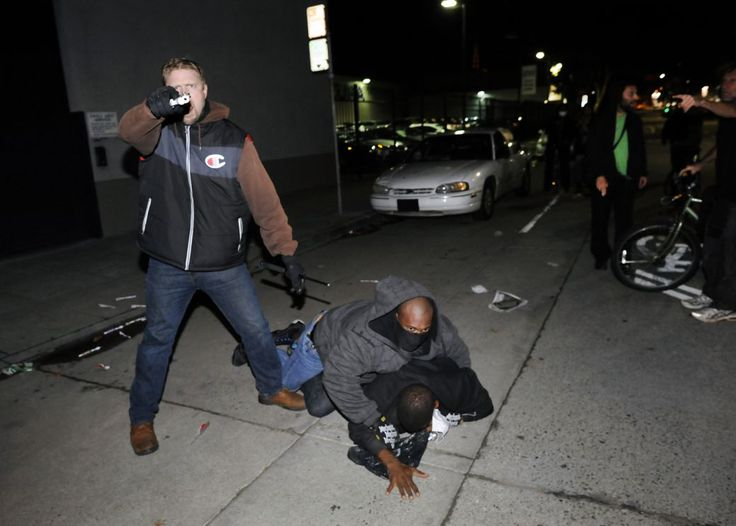 "Undercover CHP officer pulls gun at Oakland protest after outing - San Francisco Chronicle  ""Hands up, don't shoot!"""