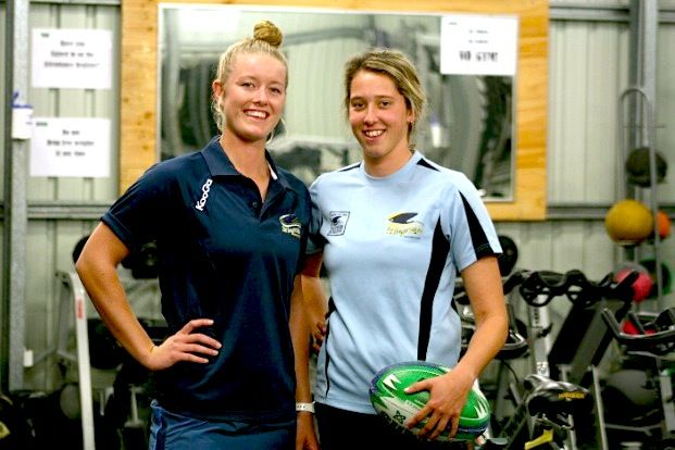 Stingrays Women's Sevens players Jo Kerr and Erica Fowler take a break from their regular gym session with a strength and conditioning trainer for this shot.