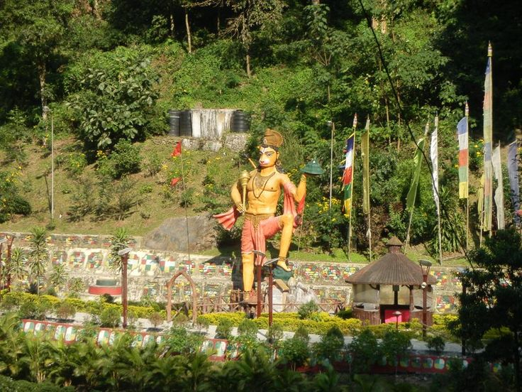 Passed a temple driving through Sikkim that was both Hindu and Buddhist. Here you see a statue of Hunuman, the Hindu Monkey God. http://www.TaoJourneys.com