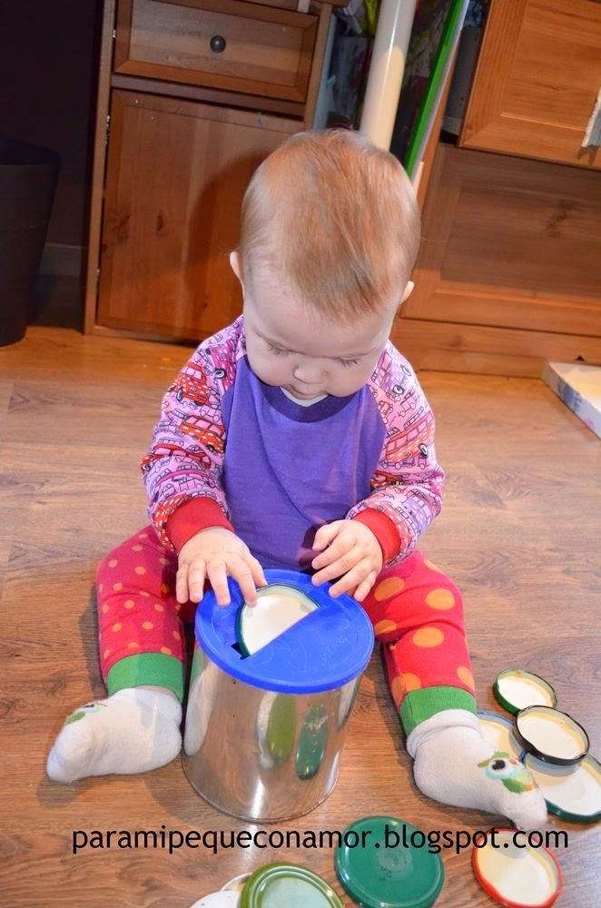 M4.1: Understanding of spatial relationships. Infants will enjoy placing the lids into a metal can just to hear the sound hearing it hit inside.