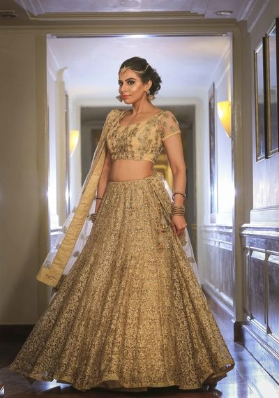 Sangeet Lehengas - Gold Sequinned Lehenga with a Gold Sheer Blouse | WedMeGood #wedmegood #indianbride #indianwedding #lehenga #bridal #sangeetlehenga #gold #sequinned