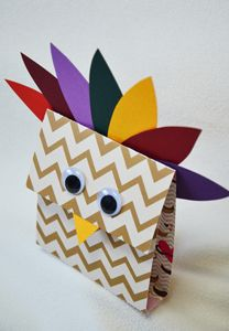 Here's a project for a Thanksgiving Day kids table.  You can make these decorations ahead of time or you can set out the supplies and have them make the decorations while dinner is being prepared.