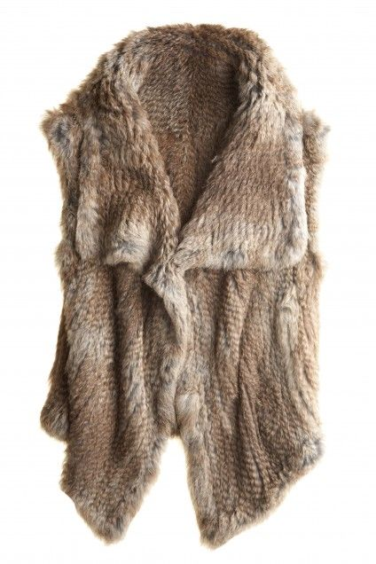 A dwindling summer calls for Autumn's most lavish accessory, the chic fur vest. Constructed of beautifully soft rabbit fur, the relaxed silhouette ensures it will compliment endless ensembles.