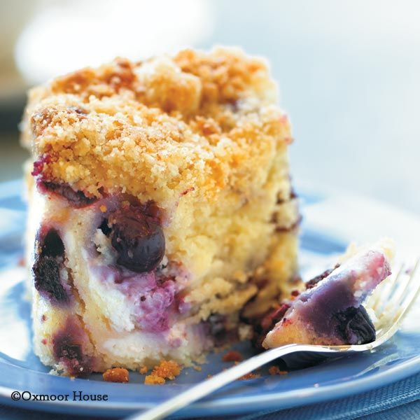 Blueberry 'n' Cheese Coffee Cake from Gooseberry Patch Best-Loved Baking Recipes Cookbook. Moist blueberry-cream cheese cake with a lemon-sugar crumb topping!
