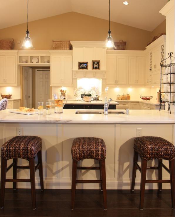 Sherwin Williams 'Camelback' warms a white kitchen