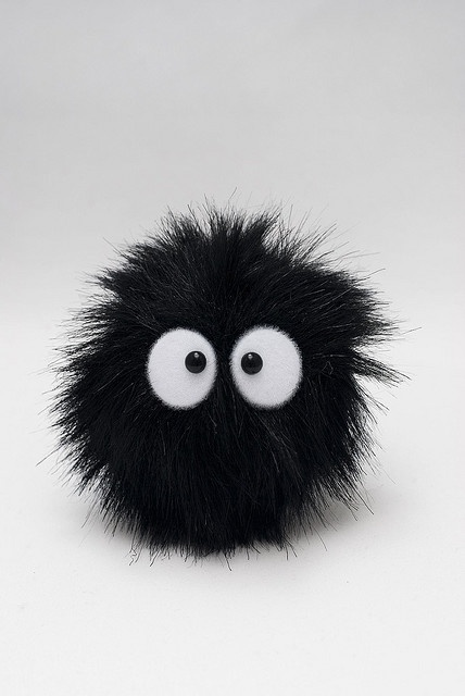 "soot sprite, or Susuwatari (Japanese ススワタリ; ""wandering soot""), also called Makkuro kurosuke (真っ黒黒助; ""pitch-black assistant""), is the name of a fictitious yōkai which was devised by Hayao Miyazaki, drawn by Ghibli studios and known from the famous anime-productions My Neighbor Totoro and Spirited Away where, in the former, they are identified as ""black soots"" in early subtitles and ""soot sprites"" or gremlins in the later English dubbed version"