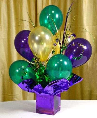 Balloon Centerpieces - Air-filled balloons make festive #centerpieces that can be created days in advance and can last for weeks. Standard helium balloons last a few days. Good for outdoor events where helium balloons can get blown around by the wind.