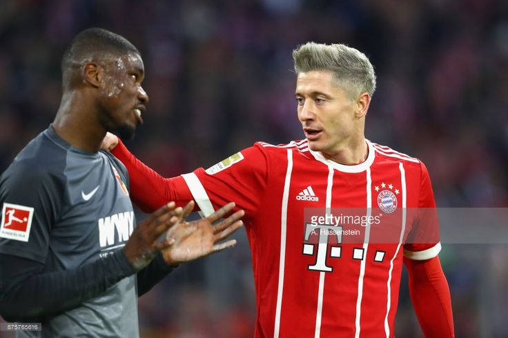 Robert Lewandowski of FC Bayern Muenchen talks to Daniel Opare of Ausgburg  during the Bundesliga match between FC Bayern Muenchen and FC Augsburg at Allianz Arena on November 18, 2017 in Munich, Germany.  (Photo by A. Hassenstein/Getty Images for FC Bayern )