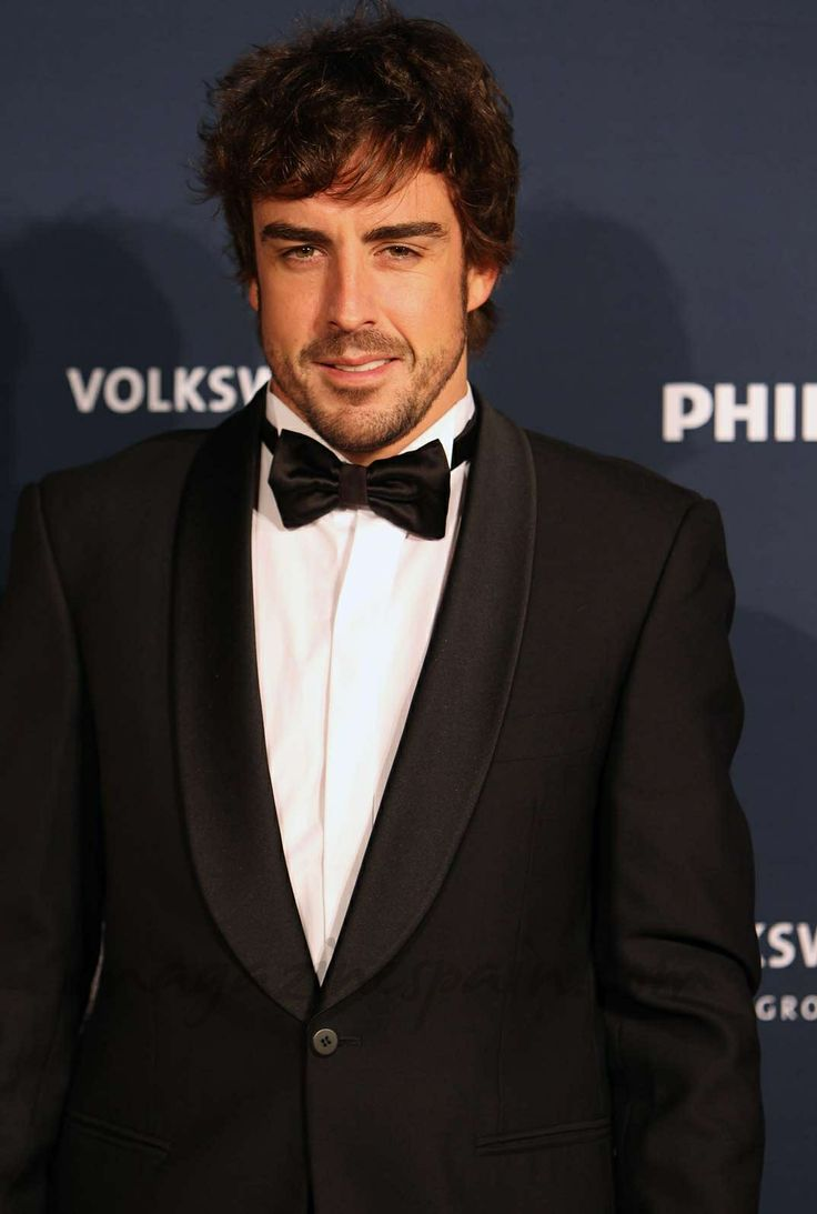 Fernando-Alonso--definitive proof that a well worn suit to a woman is what lingerie is to a man.