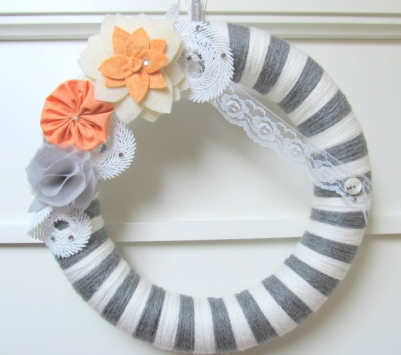 Lovely gray yarn wreath with lace and peach flowers. Simply gorgeous!