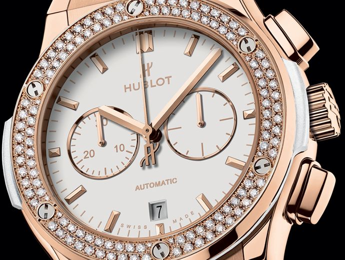 Hublot Classic Fusion White Chrono is a perfect harmony of white dial, leather strap and diamonds