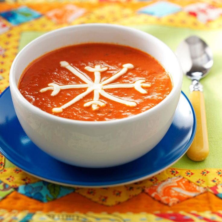 Snowflake Tomato Soup Recipe -Your family is bound to dig in to this brimming bowl! The sensational soup packs lots of pleasing ingredients, and is extra fun to eat when you pipe on a sour cream snowflake. —Taste of Home Test Kitchen