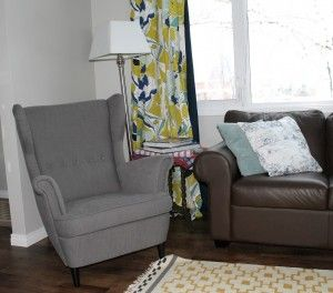 Strandmon chair ikea. With grey walls and brown couch.
