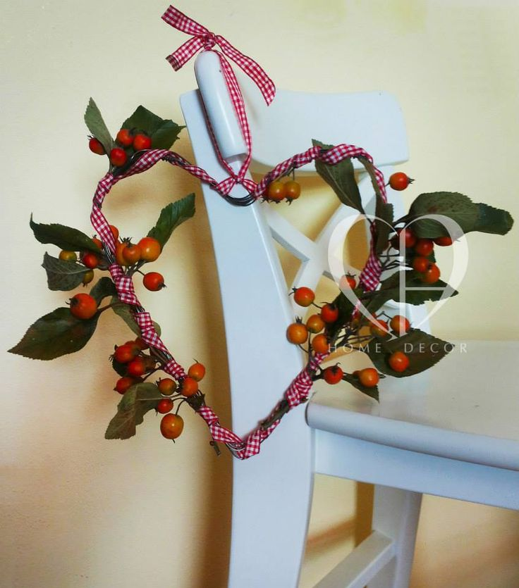 small wreath made of wire in the shape of heart with wild fresh apples gingham red gingham ribbon