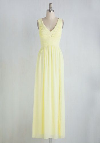 This pale yellow dress makes for an ensemble that looks polished with complexity, but only takes seconds to achieve. Simply slip into the softly gathered bodice, intersecting waistline, and sleek vented skirt of this gorgeous gown, and voila! You're prepped to take on the occasion!
