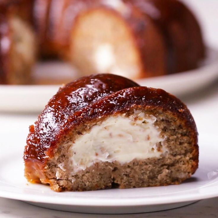 Cheesecake-stuffed Banana Bread Ring by Tasty I think I'll skip the topping. Makes it look like meatloaf.