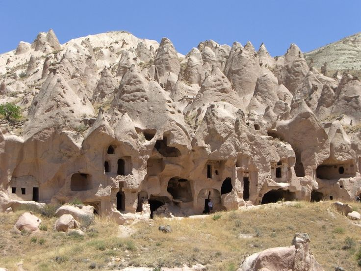 Located in the central party of Turkey (nearest big town is Kayseri), this region is dominated by a large volcano. The rock formations from its ash deposits are soft, and nature erodes them into fantastic shapes, many of them like big mushrooms.    People work the rock too. The region is full of dwellings, villages, even entire cities carved out of the stone