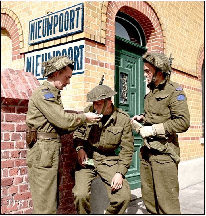 Sgt. Wilson, Privates P.J. Kraft and Henry Edward Looker, infantrymen of the South Saskatchewan Regiment, 6th Infantry Brigade, 2nd Canadian Infantry Division in Pelikaanstraat, Nieuwpoort, Belgium. September 9 1944.