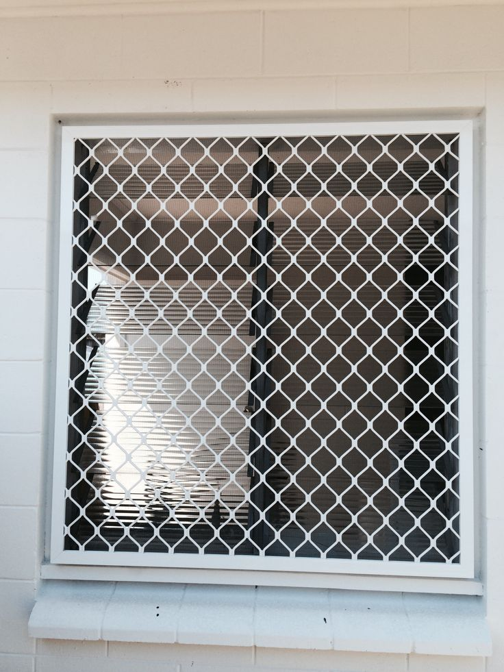 Diamond grille security window screen over glass louvres for Window cover for home