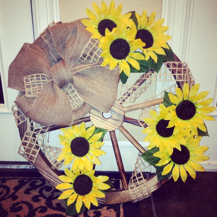 DIY Wagon wheel burlap ribbon sunflowers and hot glue