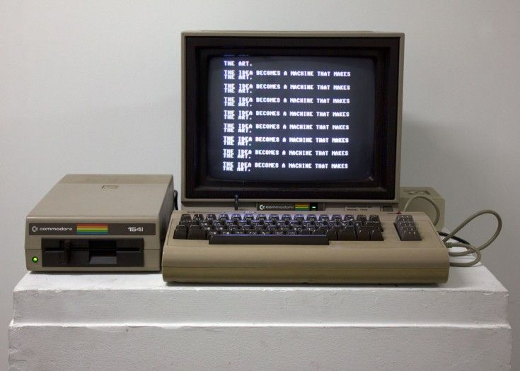 "John Slepian  Still photo of SOL, 2014 Vintage Commodore 64 computer and speech module, BASIC code, quote from Sol LeWitt's ""Paragraphs on Conceptual Art"""