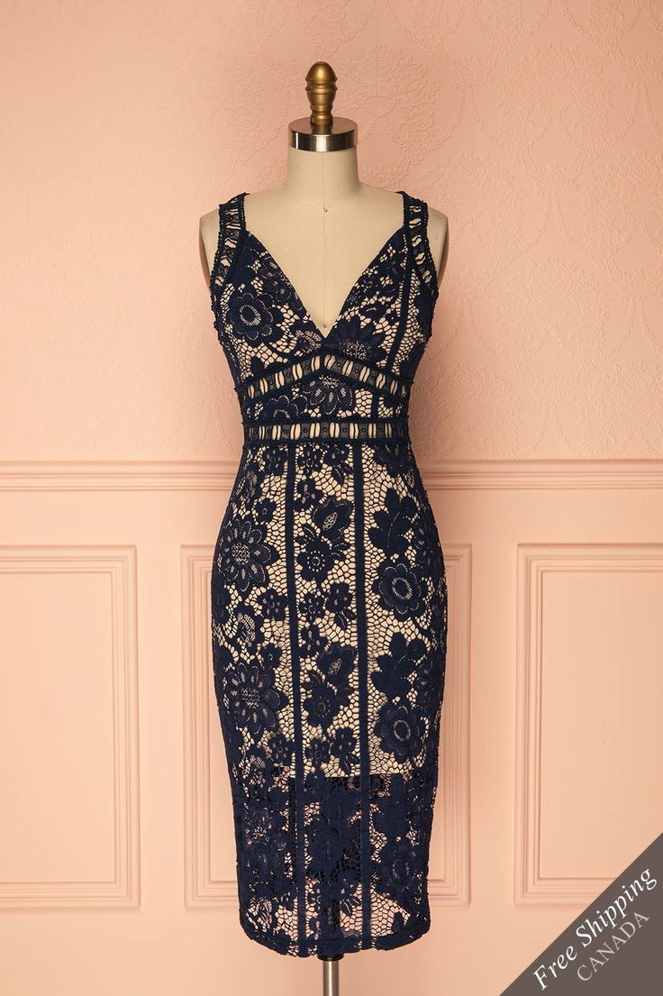 Cecy Navy #boutique1861 / This lovely crocheted lace cocktail dress is perfect for a summertime special occasion! Cut-outs at the waist, straps, and back allow the fresh breeze to cool you off. The beige lining, bust and skirt, keeps you modest. Form-fitting, it will subtly show off your curves, while the slit at the back ensures freedom of movement. Pair it with ballet flats or high heeled sandals!