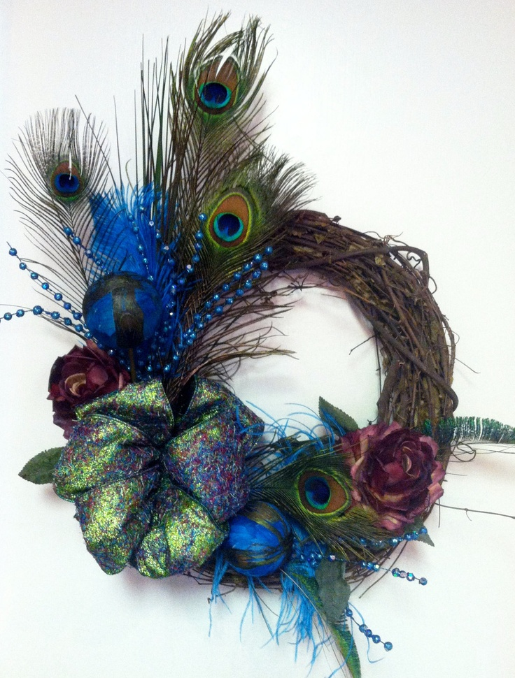 Peacock Feather Turquoise and Rose Wreath. $89.00, via Etsy.