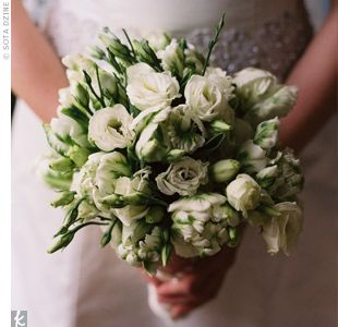 """I fell in love with parrot tulips when I first walked through the flower market a few years back,"" Meghan says. They were in season in May, so she chose those blooms to be used for all of the wedding party flowers."