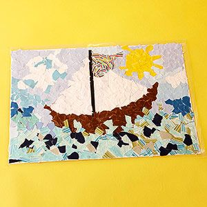 Paper Mosaic Place Mats or really cool artwork. I love how the endless possibilities for creativity. Plus this would be a great craft for recycling old papers/cards etc