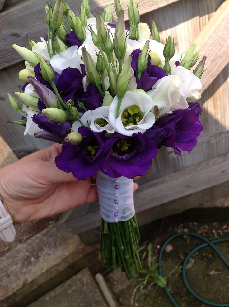 Purple and white lisianthus hand tied bouquet with buds