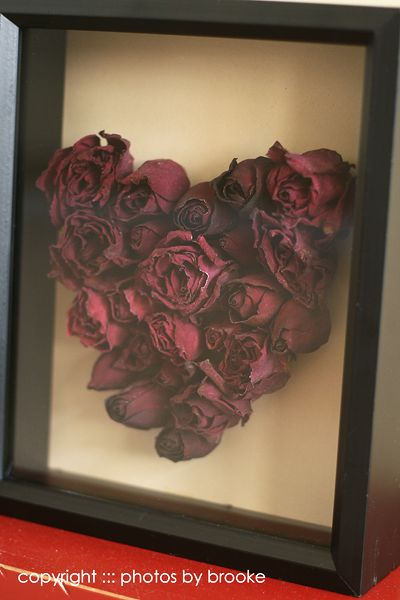 Preserve wedding bouquet by drying and gluing flower heads into a shadow frame :-)