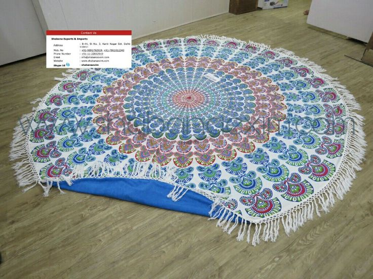 Blue round towels with long hand knotted fringes and terry backing