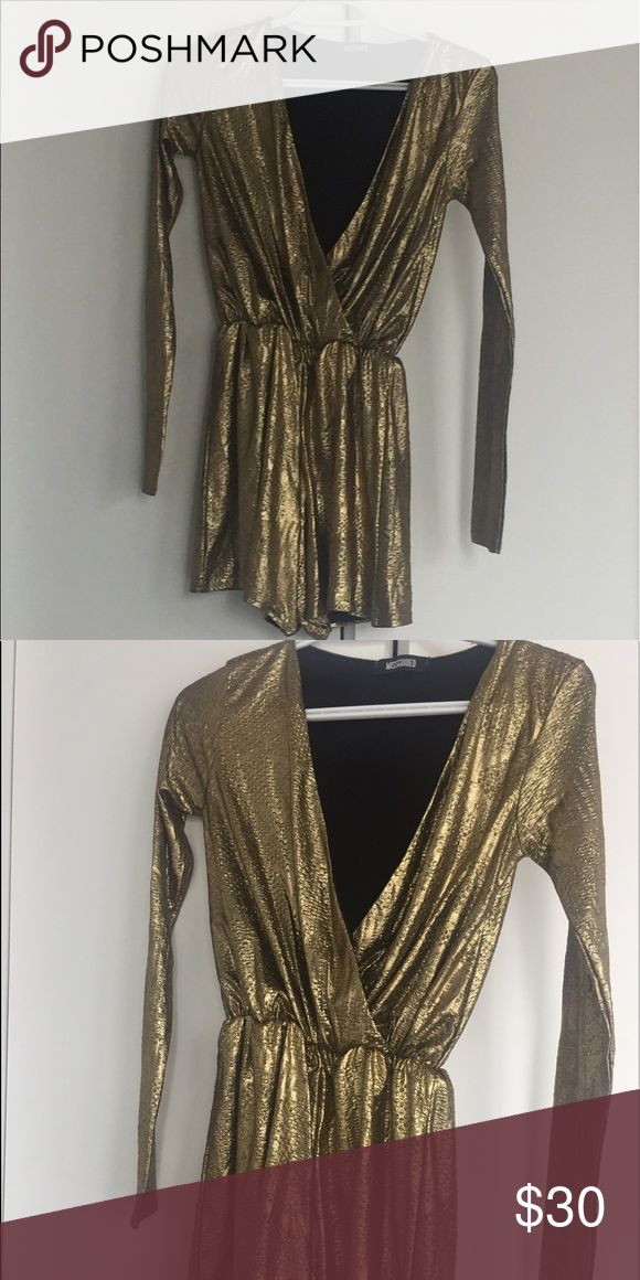 Missguided playsuit Stand out in this gold playsuit from Missguided. With long sleeves and a low front to grab attention. Missguided Other
